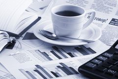 Cup coffee on  business news Royalty Free Stock Photos