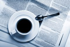 Cup coffee on  business news Stock Photo
