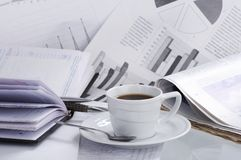 Cup coffee on  business news Royalty Free Stock Image