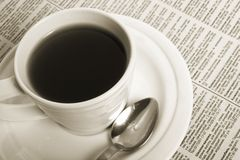 Cup coffee on  business news Royalty Free Stock Photo