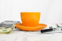 Cup of coffee, business objects and papers Stock Photography