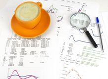 Cup of coffee, business objects and papers Royalty Free Stock Photo