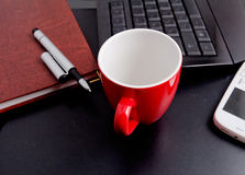 Cup of coffee and business objects Royalty Free Stock Photography