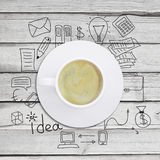Cup of coffee with business sketches Royalty Free Stock Image