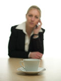 Cup of Coffee and businesswoman Royalty Free Stock Image