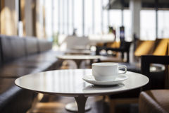 Cup of coffee cafe interior. Cup of coffee on table at coffee shop cafe interior Royalty Free Stock Photography