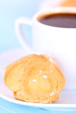 Cup of coffee and cake on blue tablecloth Stock Images