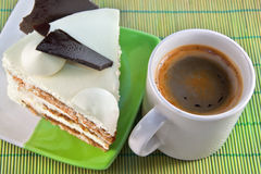 Cup of coffee and cake with chocolate. Cup of coffee and sweet cake with chocolate Stock Images