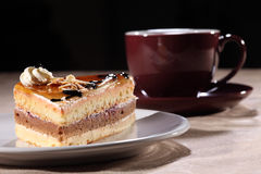 Cup coffee and cake with chocolate sauce topping Royalty Free Stock Photo