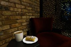 Cup of coffee, cake and cozy atmosphere. What could be better then coffee and cake in cool coffee house stock photography