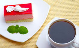 Cup of coffee and cake with mint Stock Photos
