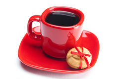 Cup with coffee ,cake nut and ribbon Stock Photos