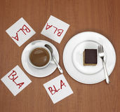Cup of coffee, cake and slips of paper on table Royalty Free Stock Images