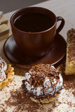 Cup of coffee and Cake on a table Stock Image