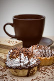 Cup of coffee and Cake on a table Royalty Free Stock Images