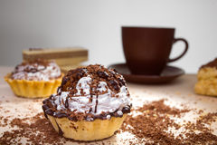 Cup of coffee and Cake on a table Royalty Free Stock Image