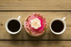Cup of coffee and cake on wooden table stock images