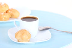 Cup of coffee and cakes on blue mat Stock Photos