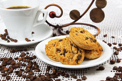 Cup of coffee and cakes. Cup of coffee and chocolate cookies Stock Images
