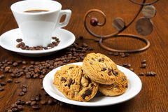 Cup of coffee and cakes. Cup of coffee and chocolate cookies Royalty Free Stock Images