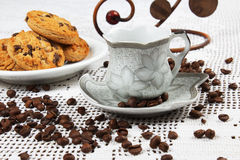 Cup of coffee and cakes. Cup of coffee and chocolate cookies with chocolate chips Stock Photography