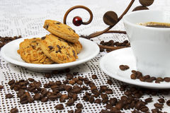 Cup of coffee and cakes. Cup of coffee and chocolate cookies with chocolate chips Stock Image