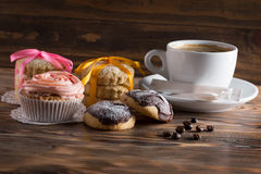 Cup of coffee with cakes and cookies on a wooden background.  Royalty Free Stock Images