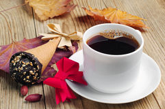 Cup of coffee with cakes in cream cone Royalty Free Stock Photography