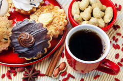 Cup of coffee, cakes and peanuts Stock Photos