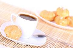 Cup of coffee and cakes on plate Royalty Free Stock Photography