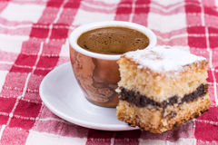 Cup of coffee with cakes on the plate Stock Image