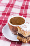 Cup of coffee with cakes on the plate Stock Images