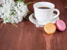 Cup coffee, cakes and white flowers Stock Photos