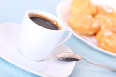 Cup of coffee and cakes on white plate Stock Photo