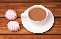 Cup of coffee and cakes. On wooden background Stock Photo