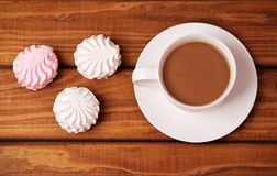 Cup of coffee and cakes. On wooden background Stock Photos