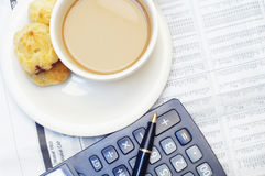 A cup of coffee and calculator Stock Photography