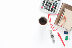 Cup of coffee with calculator and stationery on white background Stock Photo