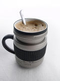 cup of coffee camera lens Royalty Free Stock Image