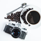 Cup coffee and camera Royalty Free Stock Photo