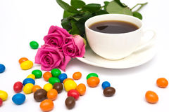 Cup of coffee, Candies and roses Stock Photo
