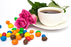 Cup of coffee, Candies and roses Royalty Free Stock Images