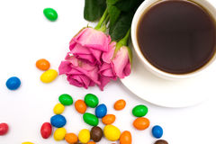 Cup of coffee, Candies and roses Stock Image