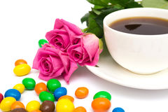 Cup of coffee, Candies and roses Royalty Free Stock Image