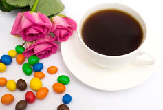 Cup of coffee, candies and roses Royalty Free Stock Photography