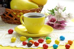 Cup of coffee and candies Royalty Free Stock Image