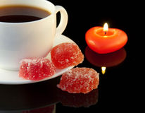 Cup of coffee and candle in the form of heart Royalty Free Stock Photo