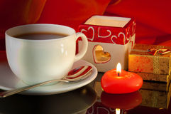 Cup of coffee and candle in the form of heart Stock Image