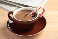 Cup of coffee with candy cane Stock Image