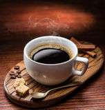 Cup of coffee and cane sugar cubes. Royalty Free Stock Photo